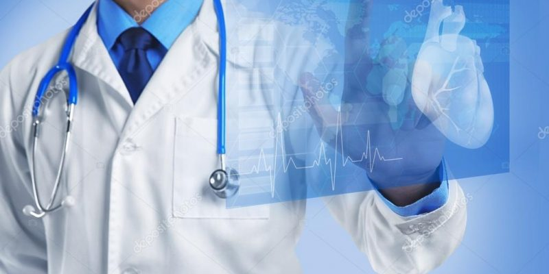 depositphotos_128659374-stock-photo-cardiologist-working-with-virtual-screen